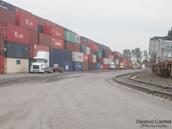 NW Container Services yard with trucks.