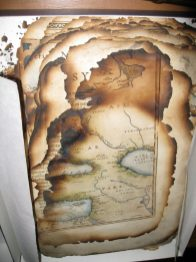 Although there is no official record, there was seemingly a fire in the Laudian Library during the 19th century in which a number of texts were damaged. The Library holds several editions of Abraham Ortelius's Theatrum Orbis Terrarum, the first world atlas ever published: the Library's only first edition, however, is among the burned fragments.