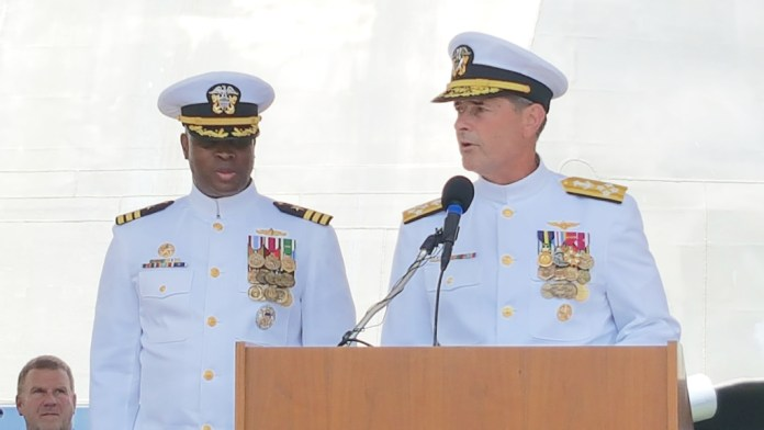 Adm. William Moran, right, turns over command of the littoral combat ship USS Gabrielle Giffords to Cmdr. Keith Woodley Saturday in Galveston, Texas.