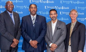 From left, UVI President David Hall, new men's basketball coach Jeff Jones, UVI Athletic Director Wilberto Ramos and UVI soccer coach Charles Long. (Photo © Aisha-Zakiya Boyd)