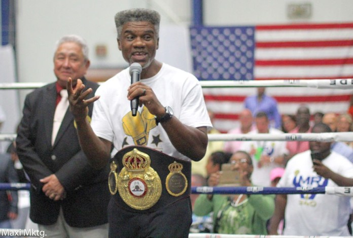 Three-time world boxing champion Julian 'The Hawk' Jackson receives a replica of his first world title belt at Saturday's boxing event. (Photo by Max Schanfarber)