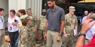NBA star Tim Duncan meets with members of the National Guard.