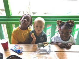 Gifft Hill School first graders eat lunch on their first day back at school.