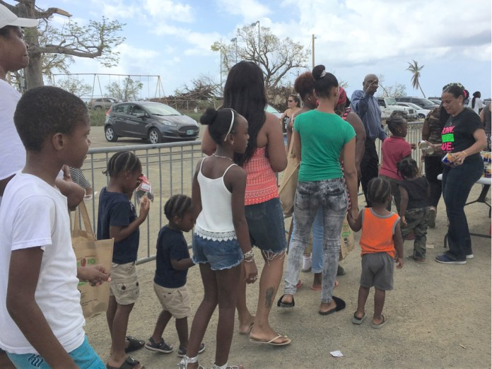 People line up in Frederiksted's Midre Cummings Park for supplies from Tim Duncan's 21 USVI Hurricane Help on Sunday. (Ivy Hunter photo)