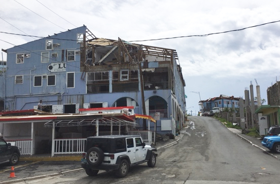 The streets of St. John are getting cleared of debris, but St. John still bears the scars of hurricane daamge.