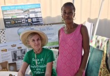 Sharon Coldren of Coral Bay Community Council and Linda Titre, a Hard Labor resident, enjoy the Bizarre Bazaar.