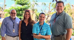 FEMA public information officers, from left, Manuel Broussard, Eric Adams and Bruce Bouch with Rachel Rochfal of the St. John Community Foundation.