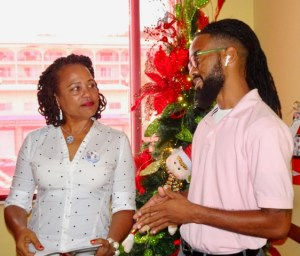 Melody Rames of the Crucian Christmas Festival and Shamari Haynes, owner of the Simpl y Sophisticated Fun Troupe, winner of the festival's Adult Parade.