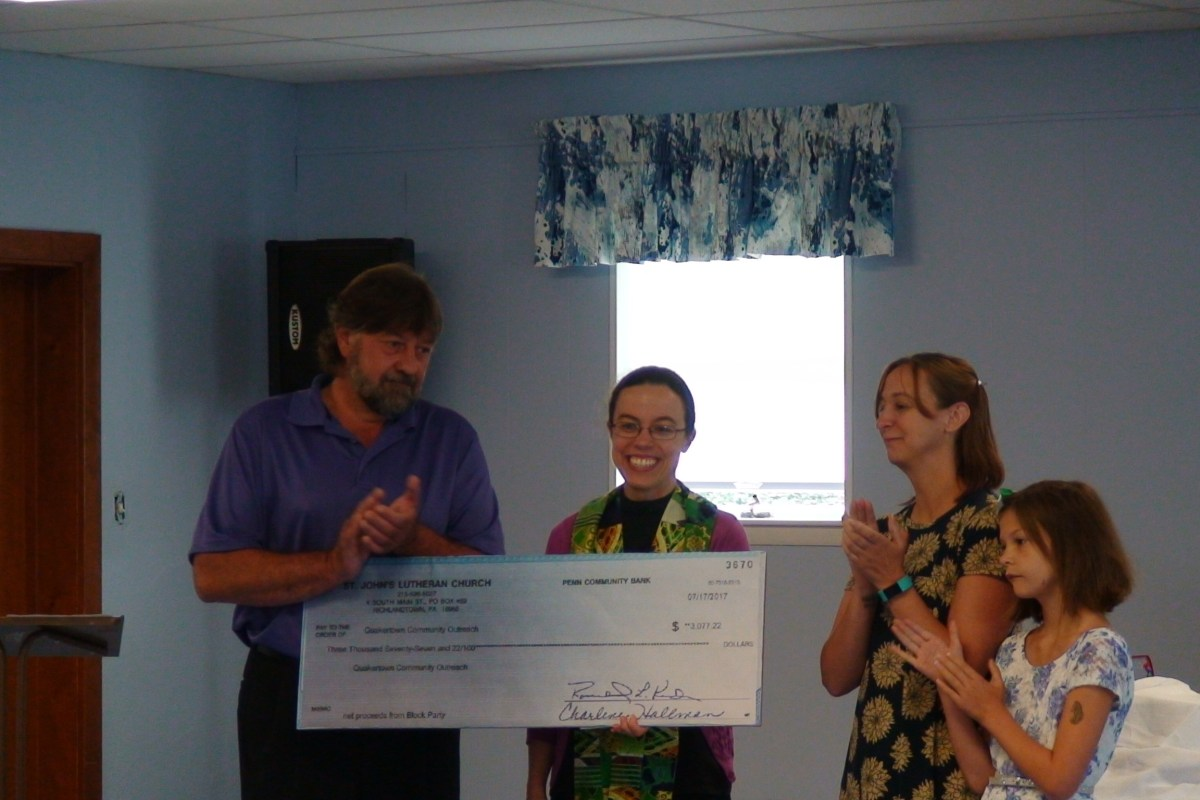 Pastor Kat Presents Check to Dave and Nicole of QCO