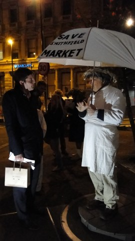 One of the actors telling his tale to an interested passer-by