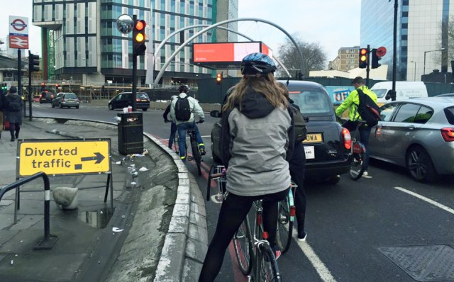Cyclists mix with traffic waiting at a junction on the intimidating three lane Old Street roundabout. Photo credit: Valerie Browne