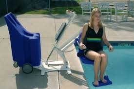 girl using mobility device to get into pool