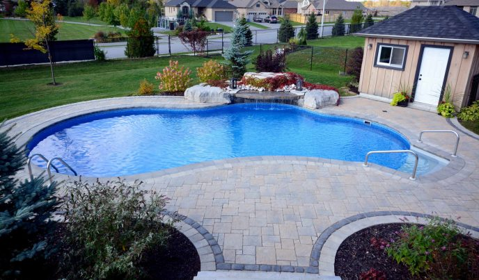 St Lawreence pools with pool house and waterfall feature