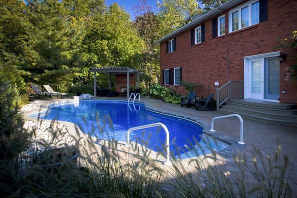 inground pool woth inground stairs and above ground railing
