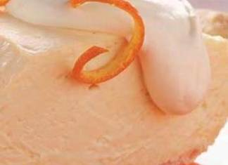 Yogurt, lower-fat cream cheese and orange juice concentrate make this Rich and Creamy Orange Cheesecake Pie light and refreshing.