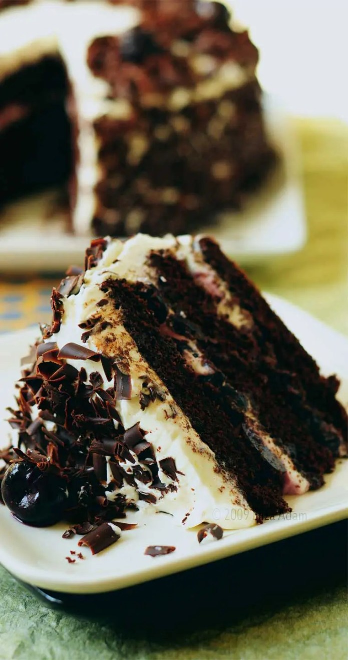 This Black Forest Cake is a glorious show-stopper of a cake that everyone is sure to fall in love with. #chocolate #cherry #cake #dessert