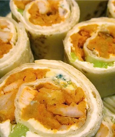Recipe for Buffalo Chicken Pinwheels - These are incredibly easy to make for your party buffet. These appetizers pack all of the big flavors of Buffalo Chicken wings and their traditional accompaniments into one easy to eat, mess-free treat