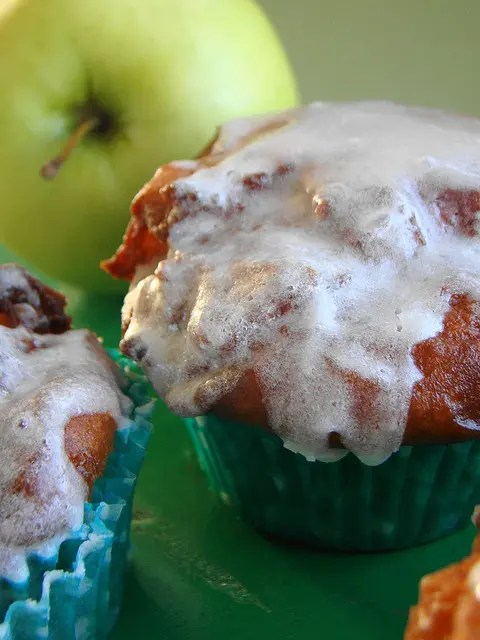 Baked cinnamon fritter batter with Pippin Apples....fried and glazed with cinnamon drizzle. TheseApple Fritter Cupcakes melt in your mouth!