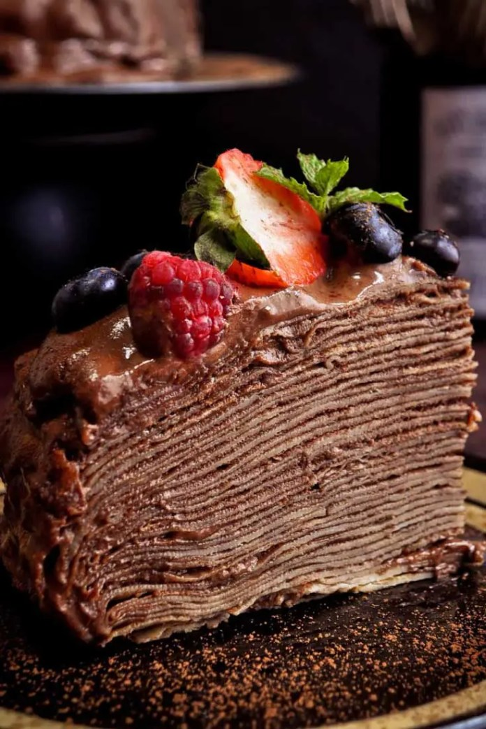 The best thing about this Crepe Cake is that it is not very heavy and rich, unlike the traditional birthday cakes that areloaded with buttercream, and neither is it overwhelmingly sweet. I loaded it with berries hoping that it would give it a nice touch!! #chocolate #cake #dessert