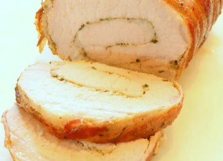 Tired of turkey? Make this recipe your new holiday tradition. Pork loin butterflied and stuffed with Dijon mustard and herbs then wrapped in bacon and roasted in hard cider.