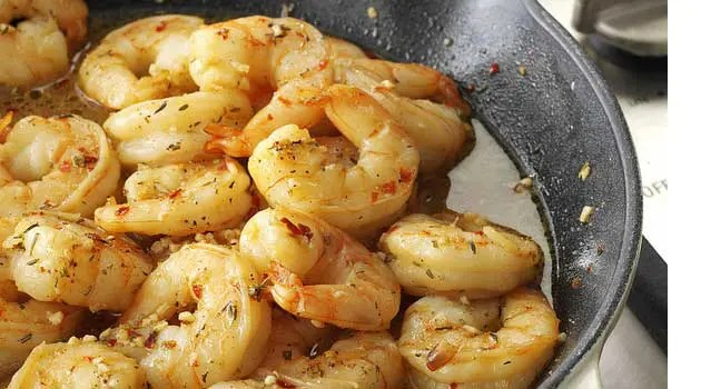 Recipe for Easy Cajun Shrimp Skillet - Indulge in this scrumptious Cajun shrimp recipe this Fat Tuesday. This easy seafood dish is loaded with bold spices, so grab some garlic bread to soak up the flavorful broth! It's excellent served with hot and creamy grits and a cold beer.