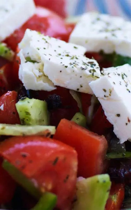 Traditional Greek Salad Recipe - The traditional Greek Salad is a fresh, tasty and sating meal. Wonderful on it's own or as a side. It contains a range of crunchy and juicy vegetables, as well as herbs and traditional Greek Feta cheese.