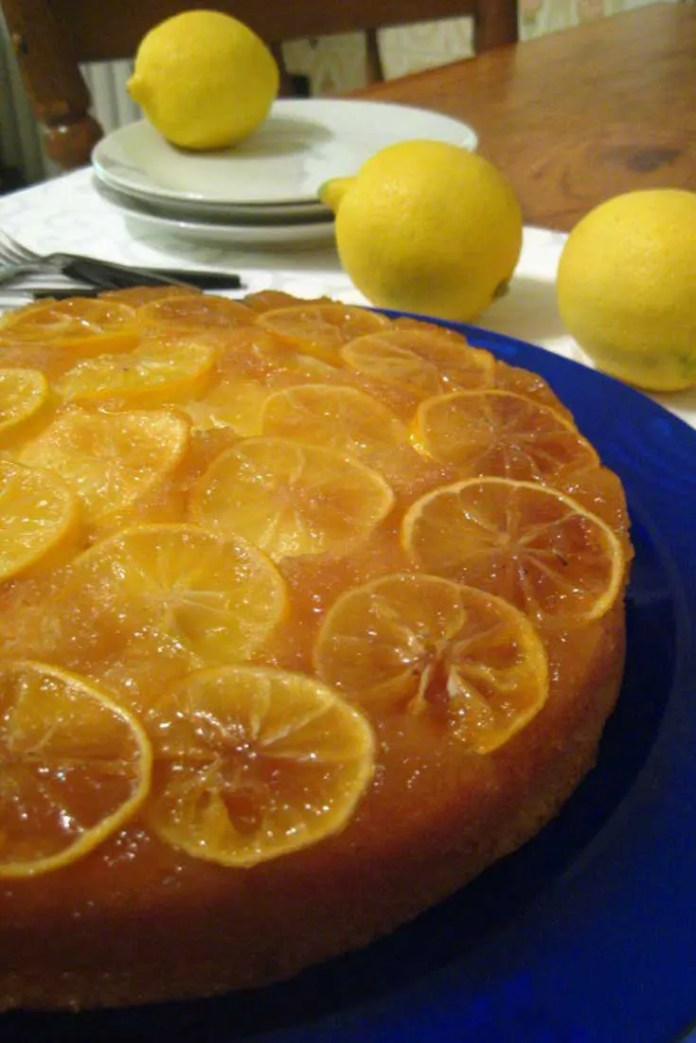A marmalade-like top (or is it bottom?) with overlapping lemon slices is a beautiful part of this scrumptious lemon upside down cake. #cake #dessert #lemon #lemoncake #lemondessert