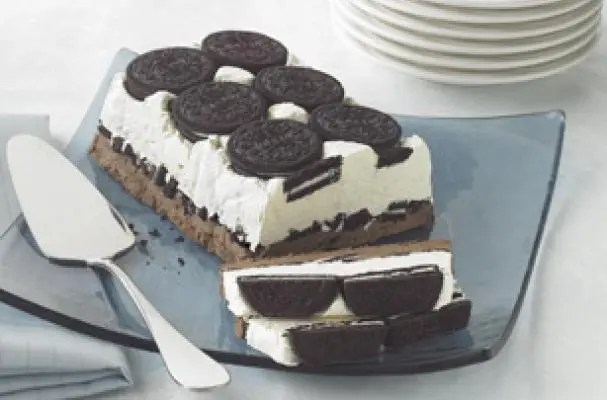 Here's the adult version of milk and cookies, a Cookies and Cream Cake. A big yummy Oreo Cookie treat with a creamy filling that's frozen, just so it can melt the hearts of dessert lovers everywhere.