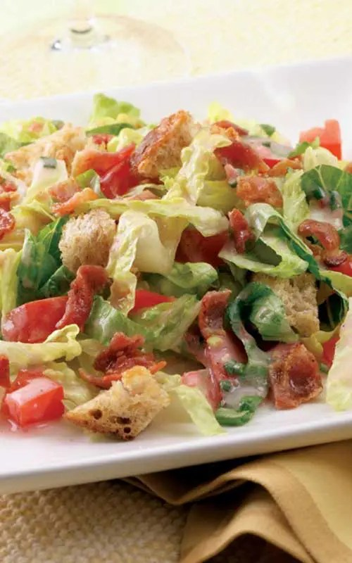 The whole family will love this quick and easy recipe based on the classic BLT sandwich. Crisp Romaine lettuce, bacon, tomatoes and cubed bread are tossed with a creamy tomato and chive dressing.