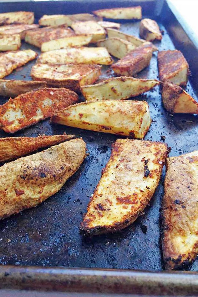 Crispy, Spicy, and Delicious. TheseCajun Potato Wedges are the perfect side for almost any dish. #potatoes #sidedish