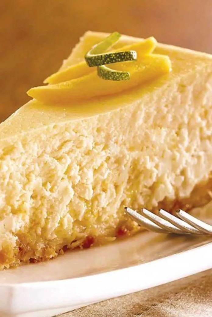 Have a taste of the tropics with this Tropical Breeze Mango-Coconut Cheesecake! This recipes is mouthwatering to look at, easy to prepare and perfect for sharing! And to top it all off...it's gluten free! #mango #coconut #cheesecake #dessert