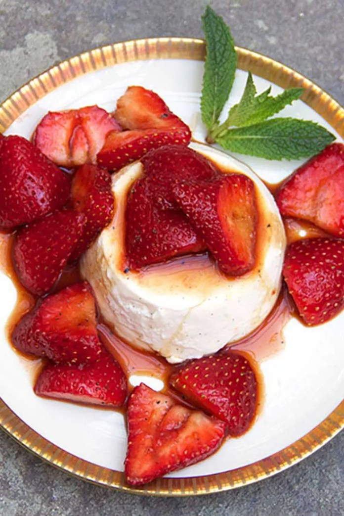 My favorite dinner party dessert - Strawberry-Vanilla Panna Cotta - gorgeous, make-ahead - the perfect delicious finale for a great meal. #strawberry #vanilla #dessert