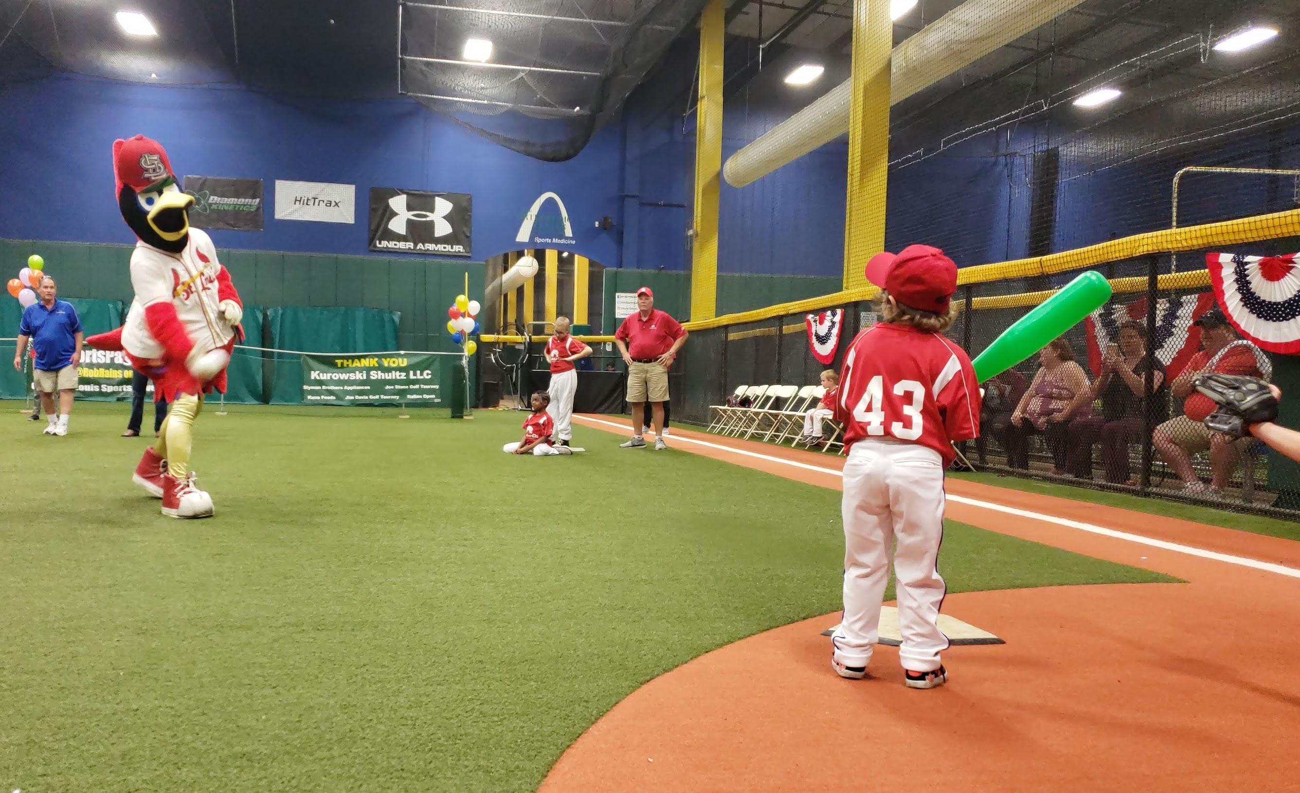Fredbird pitching to child.jpg
