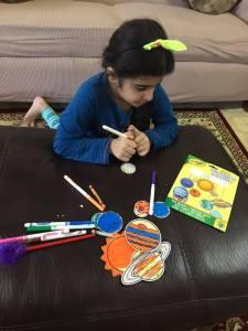 little girl doing craft