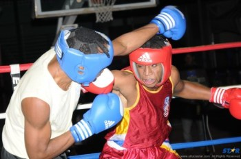 "Boxer of the Year Kyghan ""The Hitman"" Mortley (r) was deadly in the ring in 2012."