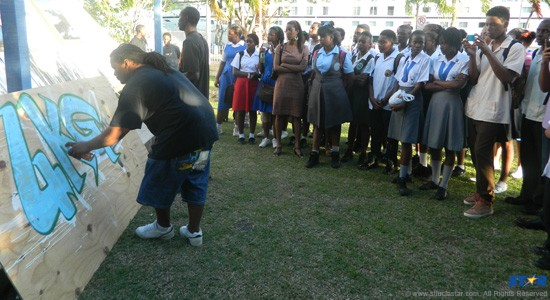 Students of the Alliance Francaise get a demonstration in the art of Graffiti.