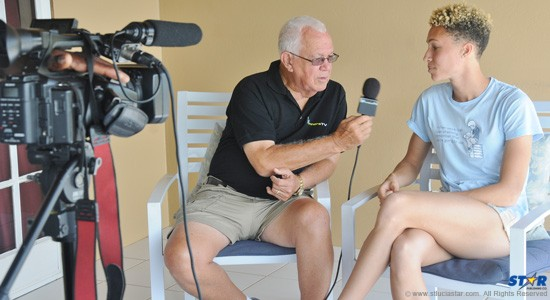 """Joseph """"Reds"""" Perreira of Winners TV during a recent interview with 2012 Sportswoman of the Year Jeannelle Scheper."""