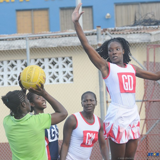 Goal Defence Roxanne Snyder (white uniform) and Shem Maxwell (background) are among the players selected for tryouts for the national netball team.