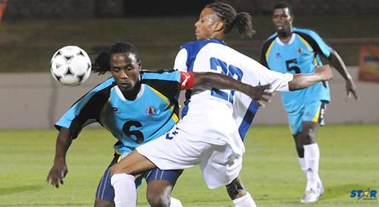 St Lucia Captain Sheldon Emmanuel (#6) and Angely Antony of Martinique got all tangled up going after a loose ball.