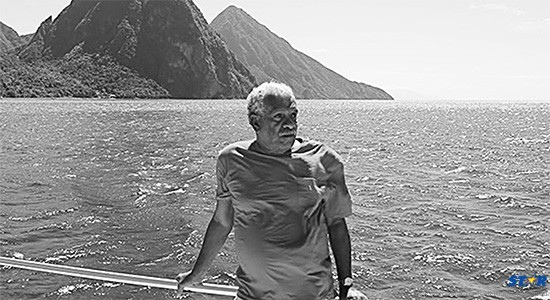 "Icons of Saint Lucia: Nobel Laureate Derek Walcott sails to his beloved Pitons in the documentary film ""Poetry is an Island."""