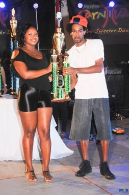 Ricky T (r) receives the third place Groovy trophy form First citizen's Nicole McDonald.