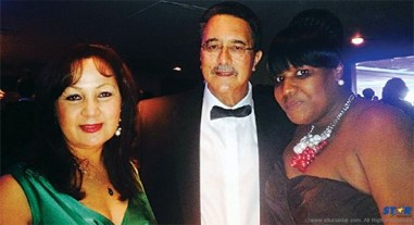Prime Minister Kenny Anthony in London, flanked by wife Rose-Marie (left) and unidentified fellow dinner guest: How long before Saint Lucia benefits from the gala event?