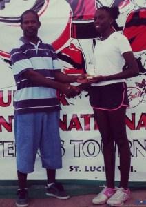 Meggan receiving her trophy from Mr. Girard of the St Lucia Tennis Association.