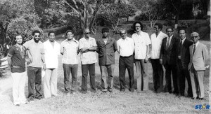 The Allan Louisy Cabinet as they appeared at Government House to take their oaths of office in 1979.  The suits at extreme right: Kenneth Foster (left to right) Evans Calderon and Bruce Williams.