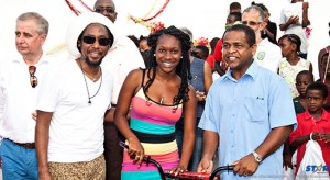 T oka group CEO John Kennedy, Taj Weekes, a parent and MP Desomnd Long.
