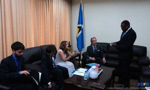 Foreign Affairs Minister Alva Baptiste (standing) meets with delegation.