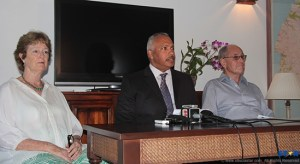 Helen and Theo Gobat with their legal representative Peter Foster (center) at a press conference here last year.