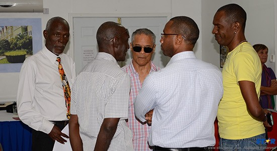 Rick Wayne (behind his signature dark glasses) exchanges views with (l-r) TCT representative Andrew Sealy, ace musician and NVC member Boo Hinkson, Media Association president Clinton Reynolds and STAR editor Toni Nicholas.