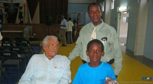 Sir-Derek-Walcott-with-Paul-Lorde---president-fo-Grow-Well-and-choir-singer
