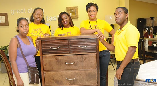 Courts OECS Marketing Team with fire victims.